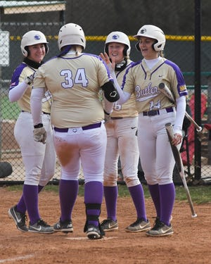 Butler freshman Brooke McCorkle is greeted at home plate by teammates Halle Hale, Emily Adler and Hannah Knox during Thursday's home conference opener with Pratt.