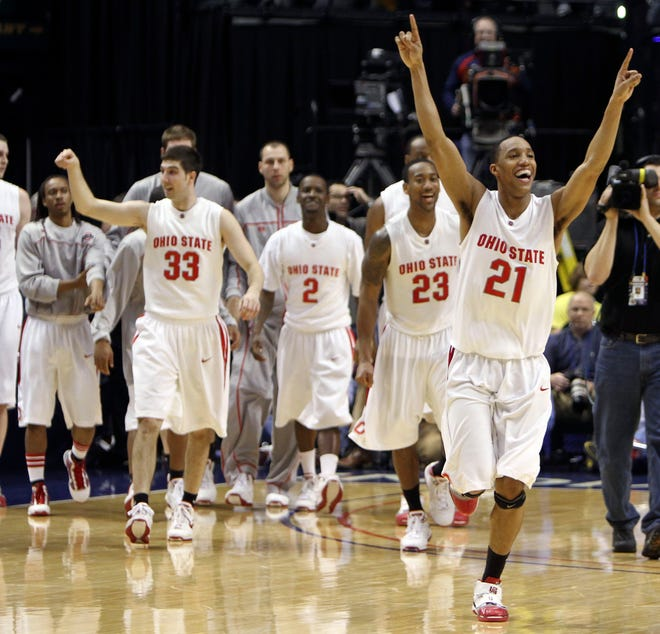 (NCL_BIGTEN_13_LAURON 12MAR10) Ohio State's Evan Turner (22) celebrates after making a three point shot over Michigan's Stu Douglass (1) to win the game in the final seconds of their Big Ten Tournament game at Conseco Fieldhouse in Indianapolis, Indiana, March 12, 2010. (Dispatch photo by Neal C. Lauron)