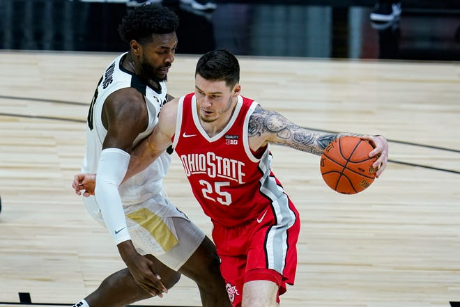 Ohio State forward Kyle Young (25) drives on Purdue forward Trevion Williams (50) in the first half of an NCAA college basketball game at the Big Ten Conference tournament in Indianapolis, Friday, March 12, 2021. (AP Photo/Michael Conroy)