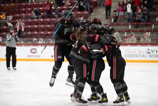 Ohio State players celebrate one of their seven goals against Minnesota Duluth in a 7-2 victory over the Bulldogs in a semifinal of the WCHA Final Faceoff.