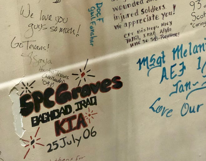 On display at the National Museum of the United States Air Force are these walls preserved from a hospital at Joint Base Balad in Iraq. The graffiti includes tributes to medical staff and fallen comrades.