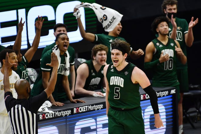 Forward Ben Vander Plas (5) and his Ohio teammates on the bench celebrate his second-half three-point goal in the Bobcats' victory over top-seeded Toledo in a semifinal of the Mid-American Conference tournament in Cleveland.