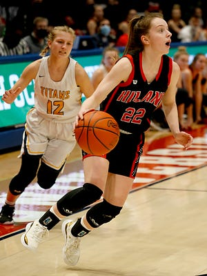 Hiland guard Kyli Horn moves to the hoop against Ottawa-Glandorf guard Lily Haselman during a Division III state final at U.D. Arena in Dayton Mar. 13, 2021.