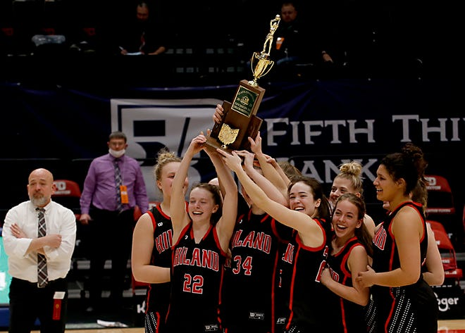 The Hiland Hawks lift the state championship trophy after defeating Ottawa-Glandorf in the Division III state final.