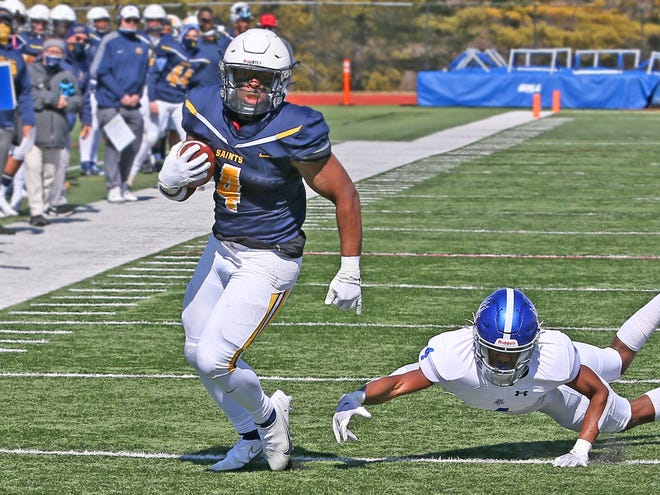 Siena Heights' Jared Jordan runs with the ball during Saturday's game against Lawrence Tech.