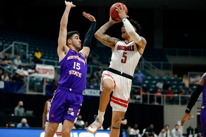 Northwestern State guard Jovan Zelenbaba (15) defends against Nicholls State forward Najee Garvin (5) during the first half of an NCAA college basketball game in the Southland Conference men's tournament semifinals Friday, March 12, 2021, in Katy, Texas. (AP Photo/Michael Wyke)
