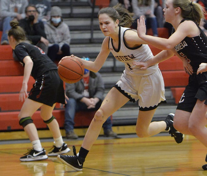 Fairview High School sophomore Sara Gennuso, center, drives to the basket near Lakeview senior Danielle Sontheimer during the District 10 Class 3A basketball championship on Saturday in Fairview Township.