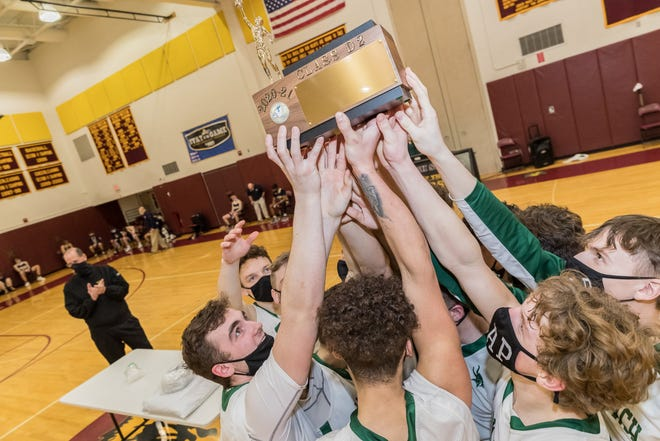 The Avoca/Prattsburgh combined team celebrates their Section V Championship on Friday evening in Avoca.