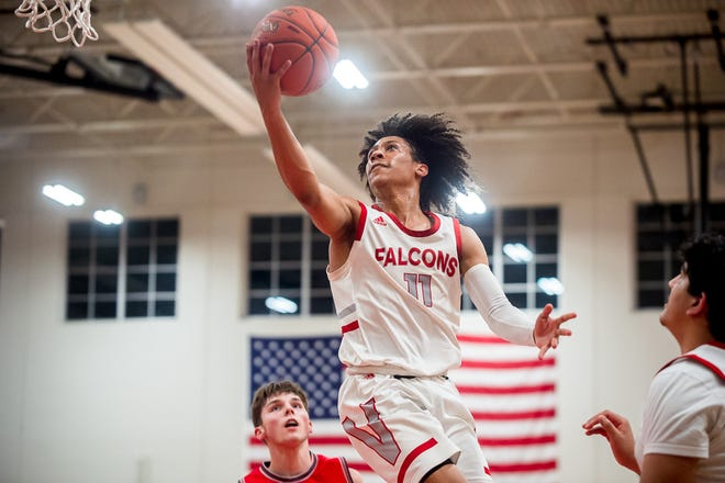 Van Horn senior guard Jaden Monday (11) glides in for a layup in a Class 5 state quarterfinal against Mexico Friday. Monday fired in a season-best 41 points to lead the Falcons to a 91-83 overtime win and a berth in the state final four.