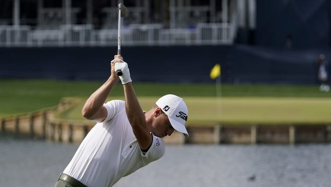 Justin Thomas hits his tee shot on the 17th hole during the third round of The Players Championship on Saturday. He shot the tournament's low round of the week with a 64.