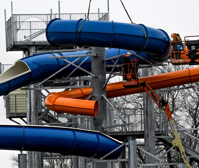 Crews fasten a portion of a water slide into place Friday as work continues on the Garden Rapids water park. The park is located on the old Big Pool site in Finnup Park.