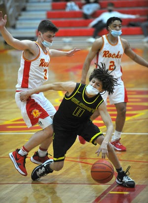 Galesburg's Kyleb Meadows works the ball around Rock Island's Colton Sigel in the second half, Friday, at Rock Island.