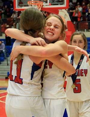 Cheney's Kylee Scheer (2) hugs Campbell Hague (11) on Saturday after they won the Class 3A state championship basketball game 60-54 against Sabetha at the Sports Arena in Hutchinson.