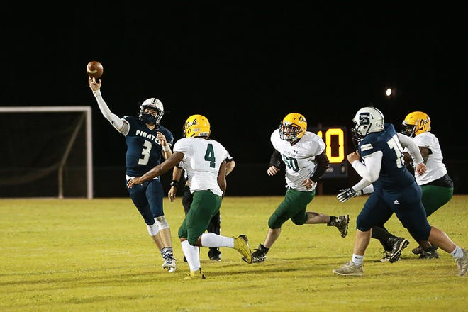 Swansboro's Damien Flores throws a pass against White Oak on Friday night.  [John Althouse / The Daily News]