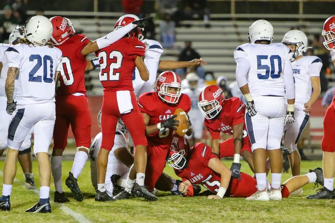 Jacksonville's Noah Gibson recovers a fumble in the Cardinals' 41-6 win over Northside on Friday night. [Tina Brooks]