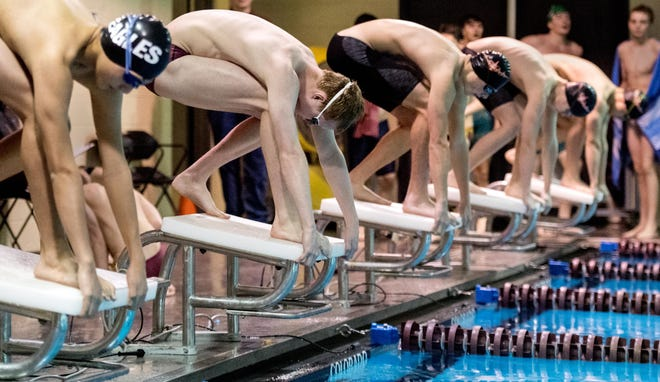Dunlap swimmer Jack Pollard, second from left, gets set to dive into the pool during a meet last season.