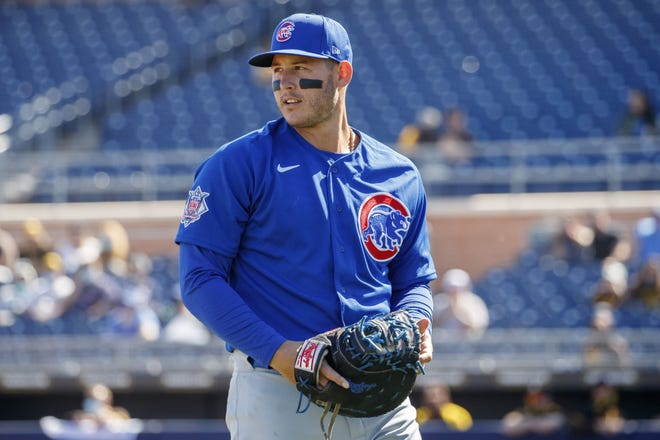 Chicago Cubs first baseman Anthony Rizzo walks to the dugout after the first inning of a spring training game against the San Diego Padres at the Peoria Sports Complex on March 1 in Peoria, Ariz.