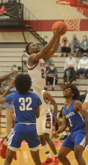 Bethel junior Jaylon Scott goes to the rim against Voorhees College Friday in the NAIA National Tournament in Wichita. Scott posted his 17th double double of the season and 46th of his career.