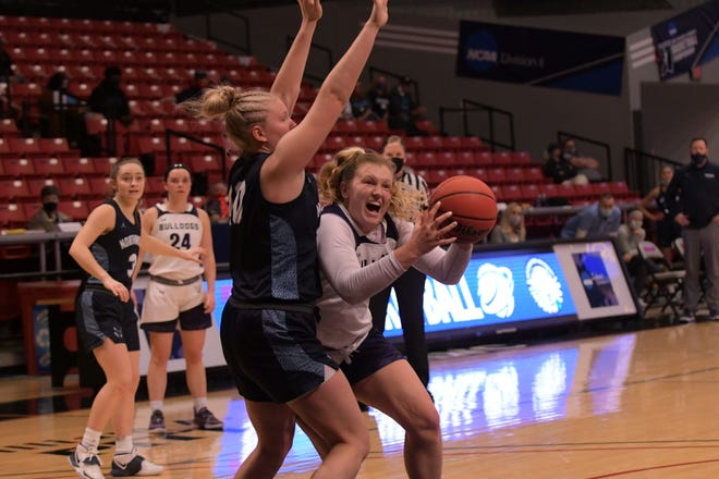 Truman's Ellie Weltha maneuvers against a Northwood defender during Friday's NCAA Tournament game in Springfield.