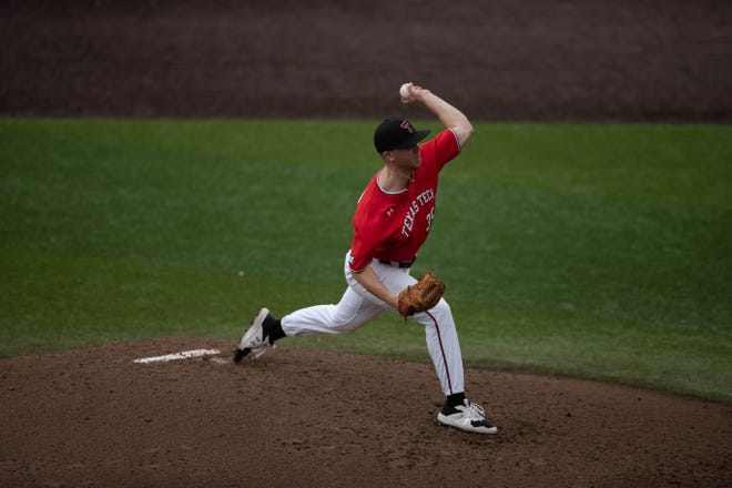 Patrick Monteverde (35) attempts to throw a pitch during a nonconference game Saturday against UConn at Dan Law Field at Rip Griffin Park. Monteverde gave up three runs, two earned, in five innings on the way to improving to 3-0 on the season.