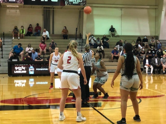 Webber's Amaya Small (right) prepares for the opening jump ball in the Opening Round of the NAIA Women's Basketball Tournament on Friday night in Lakeland.