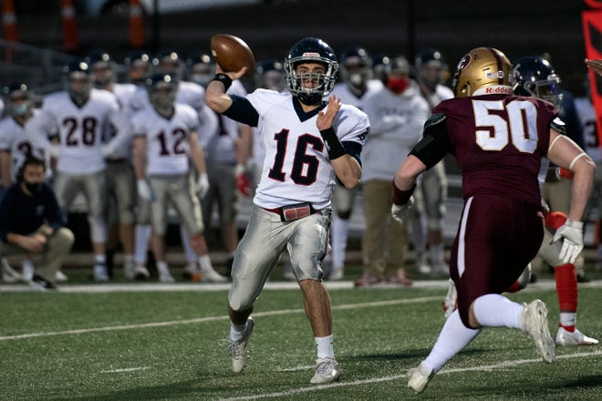 Lincoln-Sudbury junior captain and quarterback Riley O'Connell gets ready to pass to a teammate during the season-opening win over Concord-Carlisle at Memorial Field in Concord, March 12, 2021. O'Connell scored four touchdowns in the Warriors' 55-0 win over Newton South on Saturday.