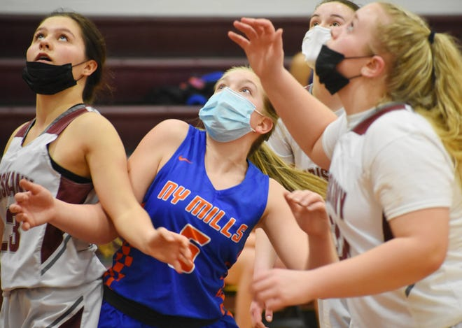 Oriskany and New York Mills girls basketball players battle for position for a rebound during a game Friday, March 12, 2021 at Oriskany High School.