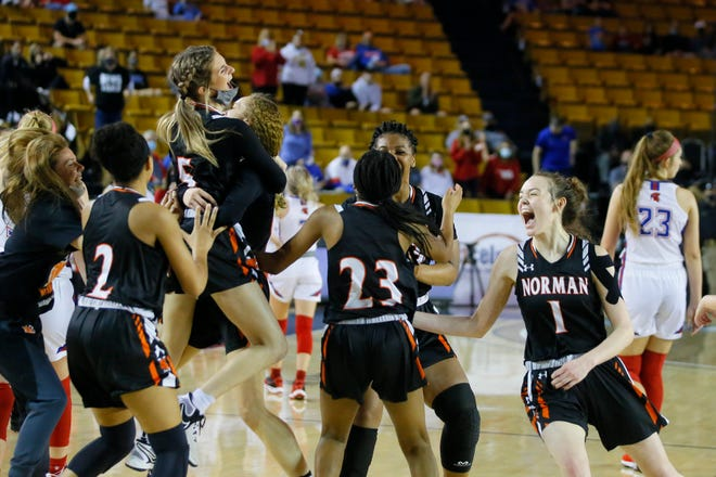 Norman celebrates after beating Bixby for the Class 6A state title Saturday at Mabee Center in Tulsa.