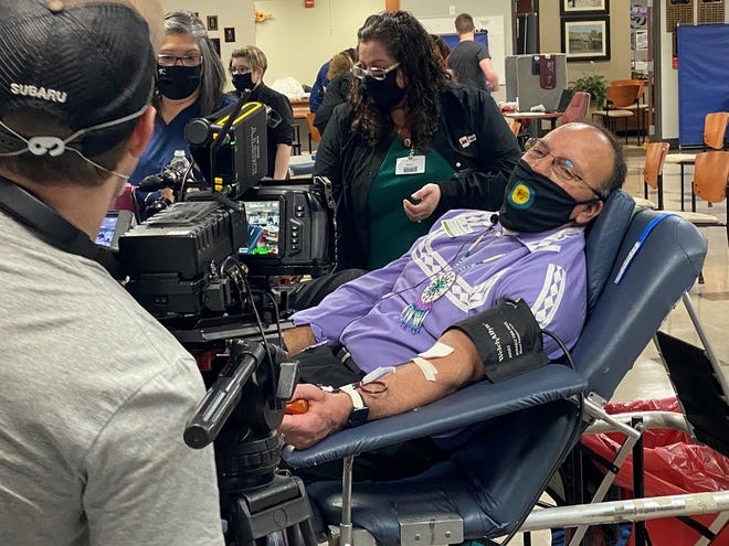 Choctaw Nation Chief Gary Batton conducts an interview while making his donation of life-saving plasma.