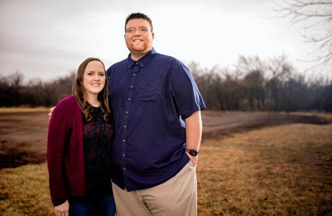 Beth and Brad Benefield have bought and cleared a lot where their new home will be built in Yukon. Construction has been delayed by COVID — one more thing that has changed in the past year for the Benefields.