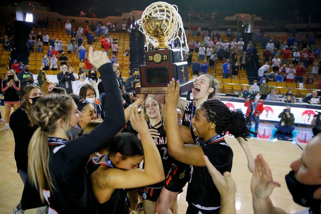 Norman celebrates with the trophy after beating Bixby in the Class 6A girls state tournament championship game Saturday at Mabee Center in Tulsa.