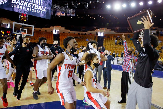 Carl Albert players run to collect their trophy after the Class 5A boys state tournament championship game against Lawton MacArthur at the Mabee Center in Tulsa on Saturday.
