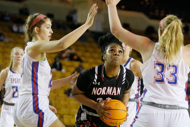 Norman's Chantae Embry goes to the basket during the Class 6A girls state tournament championship game against Bixby at Mabee Center in Tulsa on March 13.