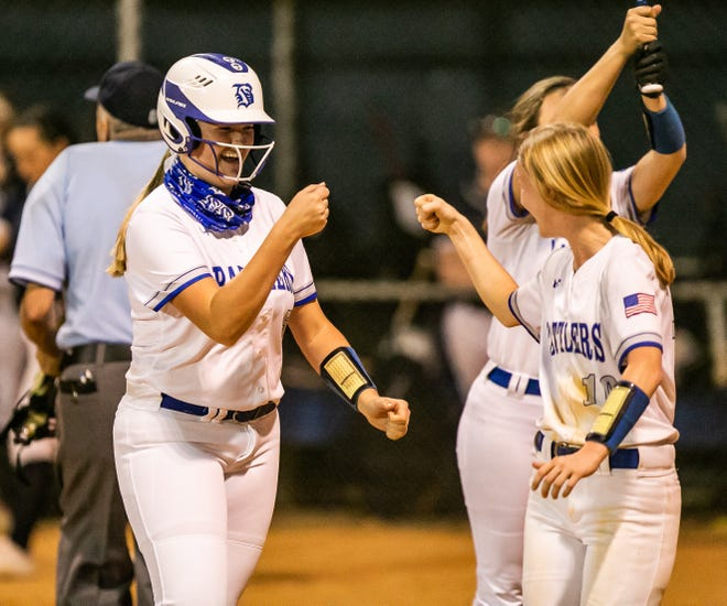 Belleview's Emma Kaylor celebrates her three-run homer with teammate Emily Pearce in the bottom of the first inning. The Belleview Rattlers defeated the South Lake Eagles, 8-3, Friday night.