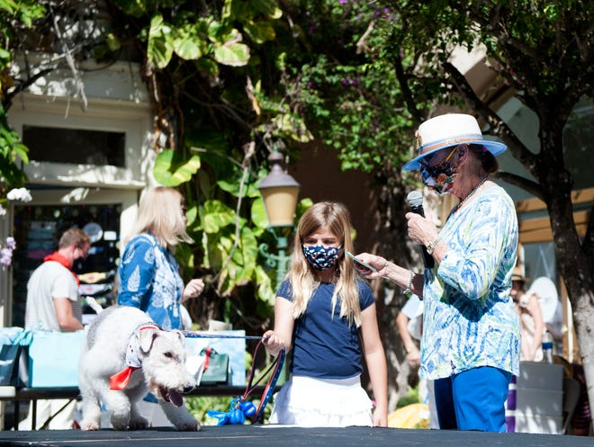 Mistress of ceremonies Sherry Frankel, right, introduces Elizabeth Rodriguez and her dog Cinco during the 28th annual Worth Avenue Pet Parade and Contest on Saturday.