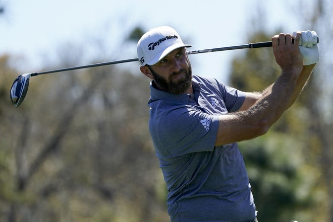 Dustin Johnson, watching his tee shot on the ninth hole during Friday's second round of The Players Championship, struggled for much of Saturday's third round and is even for the tournament.