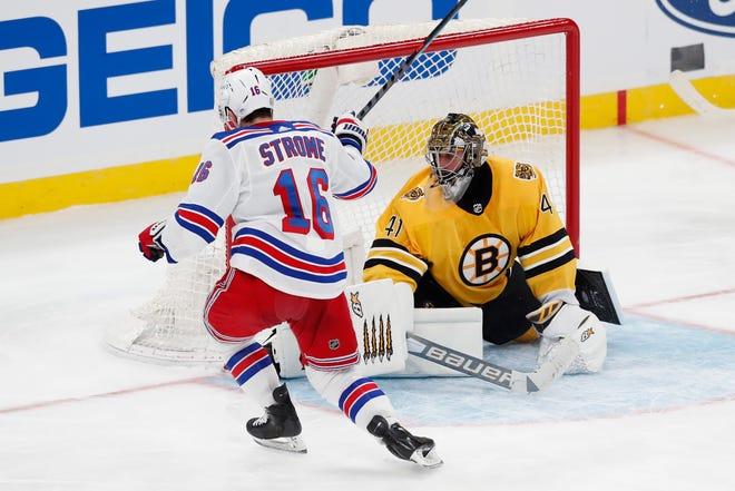 New York Rangers' Ryan Strome (16) scores on Boston Bruins' Jaroslav Halak (41) during the third period of an NHL hockey game, Saturday, March 13, 2021, in Boston. (AP Photo/Michael Dwyer) ORG XMIT: MAMD111