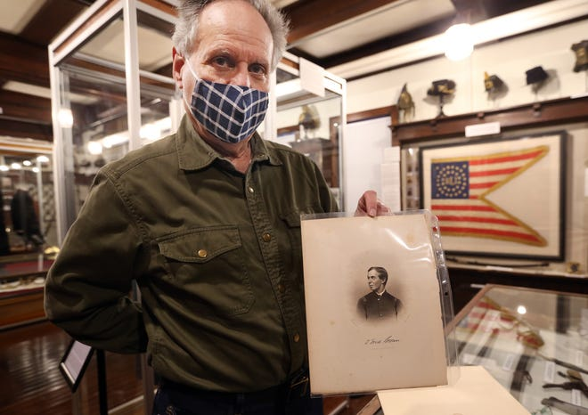 Phil DiMaria, a Civil War enthusiast from Foster and commander of 1st R.I. Light Artillery Battery B, shows a lithograph of Thomas Frederic Brown, who commanded that same unit at the Battle of Gettysburg.