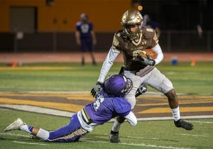 Stagg's Willie Turner, right, tries to evade a Tokay defender during a varsity football scrimmage at Stagg High School in Stockton on March 12.