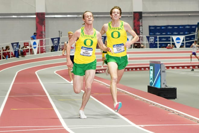 Oregon's Cole Hocker, left, and Cooper Teare finish first and second, respectively, in the 3,000-meter run Saturday in leading the Ducks to the team title at the NCAA Indoor Track and Field Championships at the Randal Tyson Center in Fayetteville, Arkansas. Hocker earlier in the day won the mile run with a meet record.