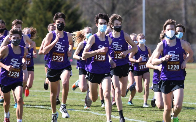 A girls and boys flight of runners from South Eugene join a cross-country meet at Marist High School in Eugene March 13, 2021.