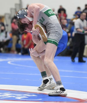 Codie Cuerbo of Aurora works to take down Brady Smith of Millersburg West Holmes in their 106-pound match in the Div. II state tournament.