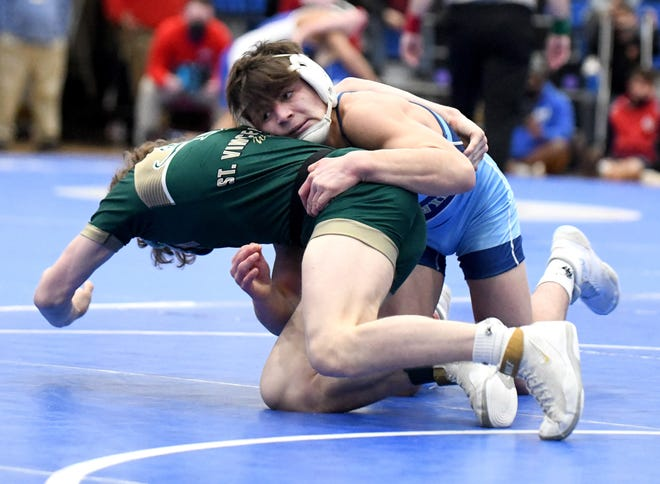 Pablo Castro of Louisville works to gain control of Elliot Allessia of St. Vincent-St. Mary in their 132-pound matchup Saturday morning in the Division II state tournament at Marengo Highland High School.