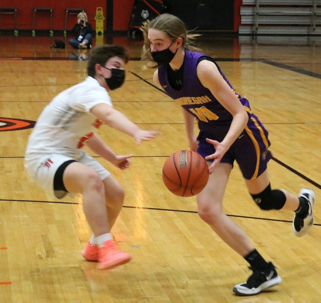 Hononegah sophomore Emma Clark drives in for two of her game-high 20 points in a 57-36 win over Harlem Friday night. The Indians won their 16th NIC-10 girls basketball title. [ALEX GARY/ROCKFORD REGISTER STAR]