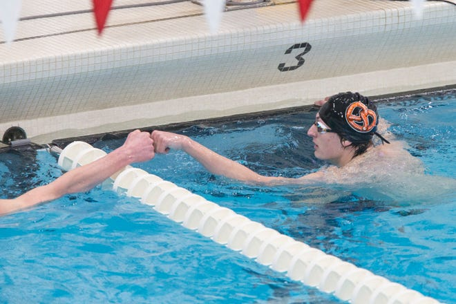 Freeport's Alexander Wilson, right, congratulates Hononegah's Davis Cass after the third heat of the 50-yard freestyle of the NIC-10 boys swim meet Saturday at Jefferson High School. Wilson won in :22.60 over Belvidere Co-op's Daniel Golonka (:22.69). Cass, his longtime rival, was third in :23.08. Wilson also won the 50 backstroke.