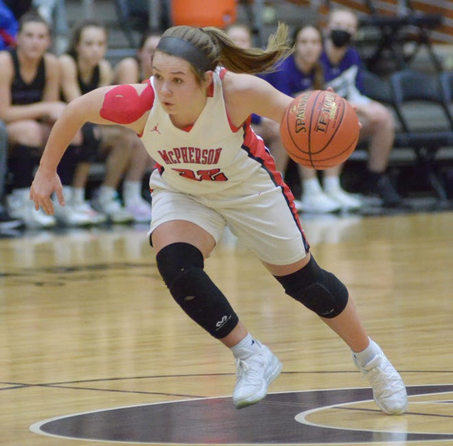 Emma Malm (32) leads a McPherson fast break during the third quarter of Friday night's Class 4A state semifinal against Louisburg at the Tony's Pizza Events Center.