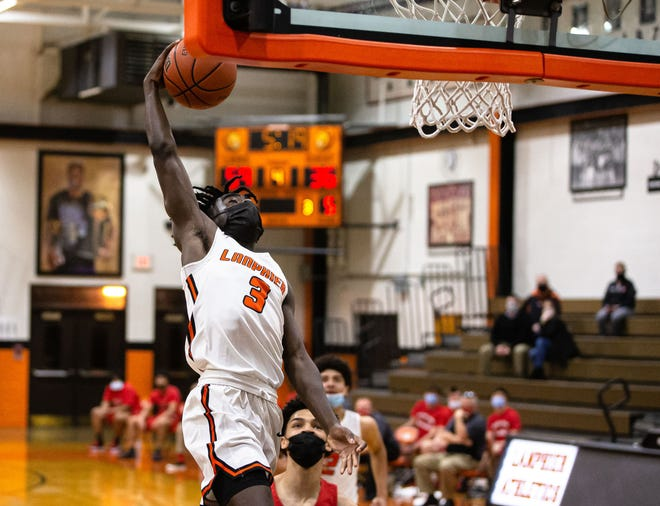 Lanphier's Camren Kincaid (3) goes up for the dunk against Springfield in the second half during the semifinals of the Boys CS8 Tournament at Lober-Nika Gymnasium in Springfield, Ill., Friday, March 12, 2021. [Justin L. Fowler/The State Journal-Register]