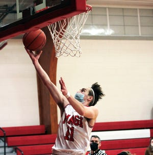LaWayne Wickey scores two points for Colon on Friday night against Bellevue.
