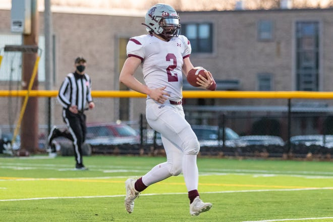 Bishop Stang quarterback Dylan Aguiar, seen earlier this season, scored one of the Spartans' two touchdowns on Friday against Bishop Feehan.