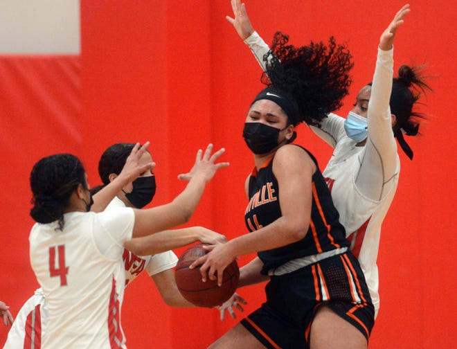 Montville's Maya Hillman is surrounded by NFA's Jenissa Varela, left, Aryaah Loftis and Anajah Ingram Friday during NFA's 52-23 win in Norwich.